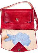 Open cherry color handbag decorated by flower Stock Photos
