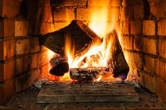 Burning wood in fire-box of fireplace Stock Photos