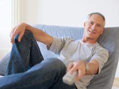 A man watching tv Kuvituskuvat