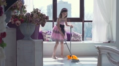Teenage girl sweeping the room Stock Footage