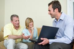 Couple and financial advisor Stock Photos