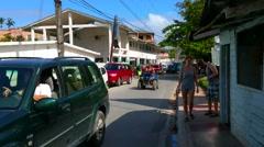 LAS TERRENAS, SAMANA, DOMENICAN REPUBLIC FEBRUARY 06 People walking and cars  Stock Footage