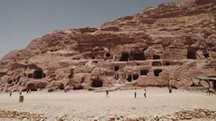 Pan shot of tombs in the lost city of Petra Stock Footage