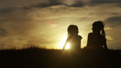 4K Silhouette children hugging at sunset, in slow motion Stock Footage