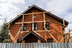 Unfinished private house from a red brick - stock photo