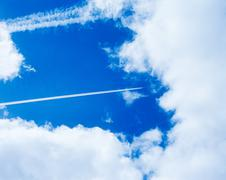 An aeroplanes vapour trail in the sky Stock Photos
