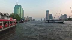 Boat along the Chao Praya river in Bangkok Stock Footage