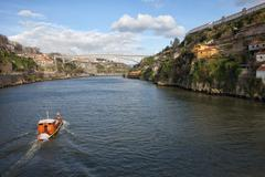 Tour Boat on Douro River in Portugal - stock photo