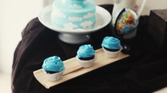 Blue cupcakes, muffins, baby birthday, cloud cake Stock Footage
