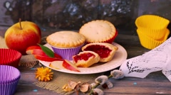Cake basket berry jam nuts filling wooden table rustic rural muffin, cupcake arm Stock Footage