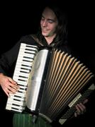 Accordion player in studio. Stock Photos