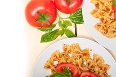 Italian pasta farfalle butterfly bow-tie and tomato sauce - stock photo