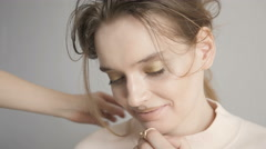 Beautiful Female Model Smiling While Doing Her Hair. Hairstylist Spraying Hairsp Stock Footage