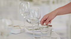 Waiter hands arranging table setting with place card for guests in a restaurant Stock Footage