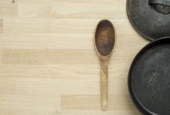 Still life of frying pan on kitchen table Stock Photos