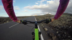 Woman Cycling On Road On Mountain Bike POV - Healthy Active Lifestyle Stock Footage