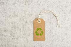 Recycle symbol on brown paper tag - stock photo