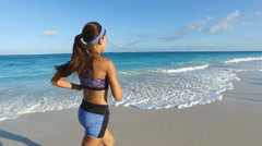Running Dedicated Young Woman Jogging On Beach - Girl Exercising In Summer Stock Footage