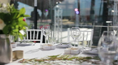 Glasses on white cloth table served for lunch or dinner in outdoor terrace - stock footage