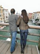 Rear view of couple on Academia Bridge. Stock Photos