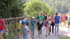 A group of tourists students walk on mountains - Carpathians green summer - stock footage