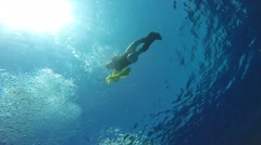 Dancing underwater divers to free dive time. Stock Footage