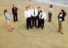 Group of businesspeople on the beach. - stock photo