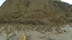 Flying along a cliff made of sedimentary rock Stock Footage
