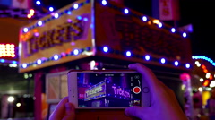 Prepare recording of ticket booth neon sign looped on smart phone Stock Footage