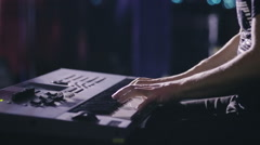Female keyboards player on stage during concert, backlight, colors intentionally Stock Footage