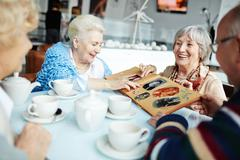 Gathering of senior friends Stock Photos
