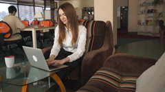 Two women working at the office using modern device Stock Footage