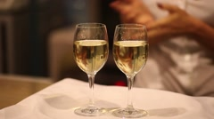 Two glasses of white wine on a tray Stock Footage