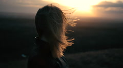 Beautiful girl watching the sunset and smiling, solar flare - stock footage
