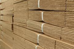Cardboard pile on corrugated cardboard texture Stock Photos