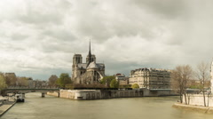 Medium zooming timelapse of Notre Dame in Paris sourrounded by the Seine Stock Footage