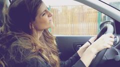 Beautiful woman with very long hair dancing happy driving car slow motion ret Stock Footage