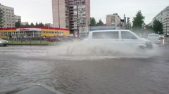 Flash Flood. A Vehicle Ploughs Driving  Through Flood Water. Russia Stock Footage