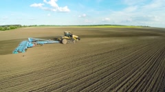 Aerial of tractor on harvest field top view from height Stock Footage