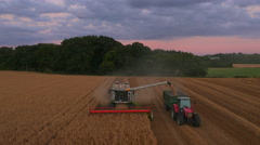 Claas Combine Harvester unloading at Sunset, UK - stock footage