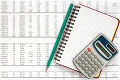 Notebook,pencil and calculator on financial statement - stock photo