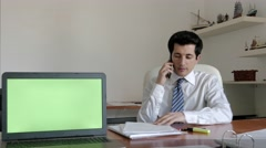 Businessman talking on the phone with a customer Stock Footage