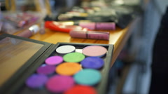 Stock Video Footage of close up bright eyeshadow palette , girl takes some white with a brush