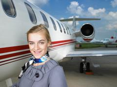 Smiling flight attendant Stock Photos