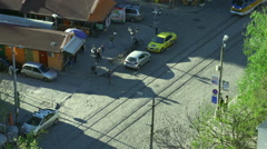 Boulevard with tram passes and people from high viewpoint Stock Footage