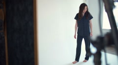backstage photoshoot model posing in pyjama slow motion - stock footage