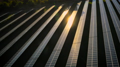 Aerial drone footage of UK solar panels at sunset Stock Footage