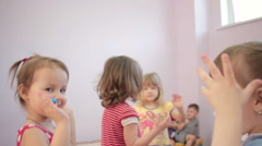 Kids playing running around dancing in kindergarten and laughter Stock Footage