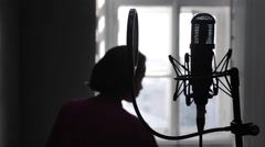 A voice teacher and student singing together in music school Stock Footage