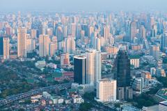 Bangkok's Crowded Skyline in the Hazy, Early Morning Light Stock Photos